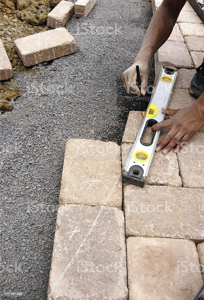 landscaper measuring walkway stock photo