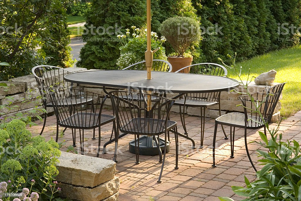 Landscaping Patio with Outdoor Furniture, Flower Garden in Hardscape Backyard stock photo