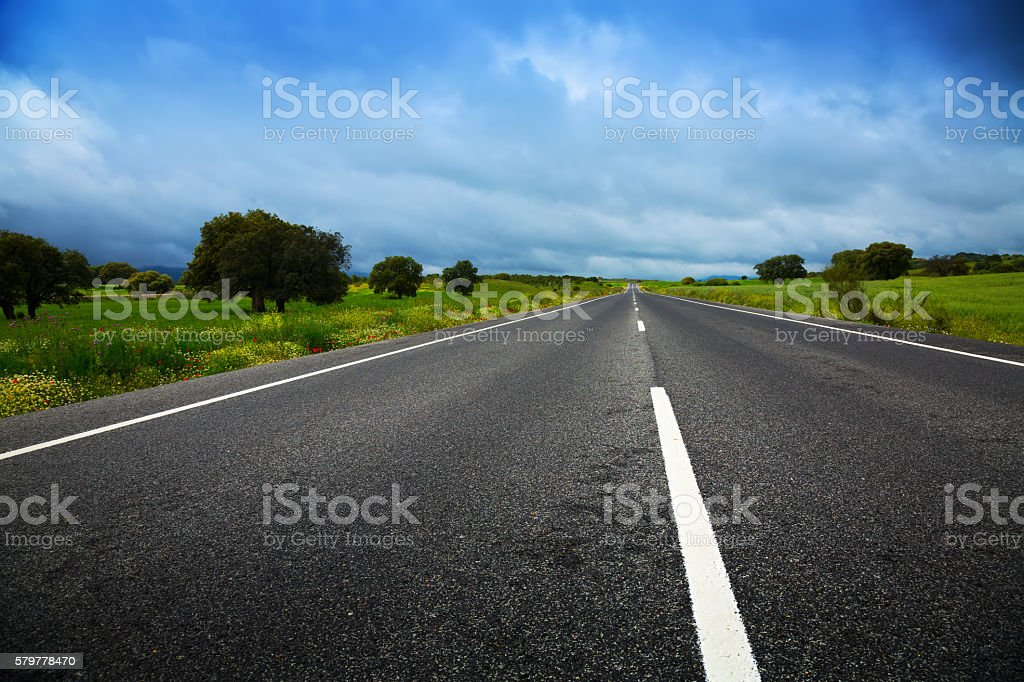 landscpae with road and heavy clouds stock photo