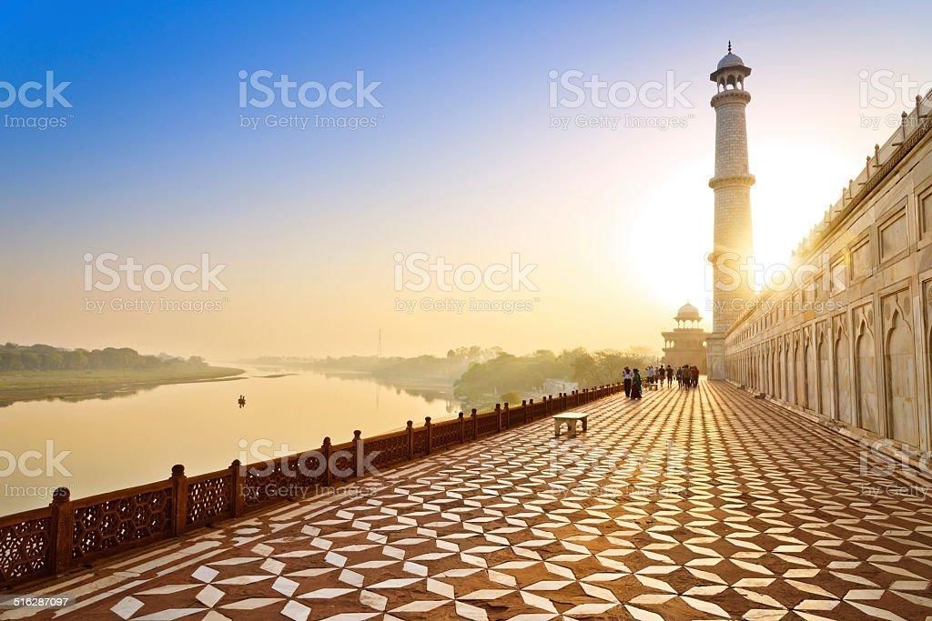 lane around the Tah Mahal at sunrise stock photo
