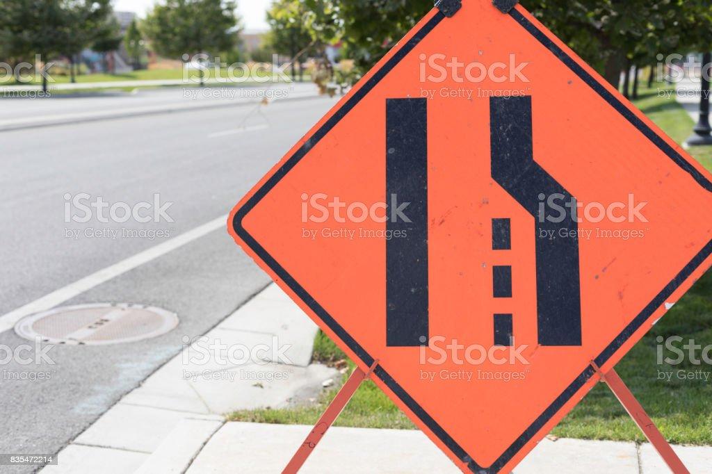 Lane Ends Merge Sign stock photo