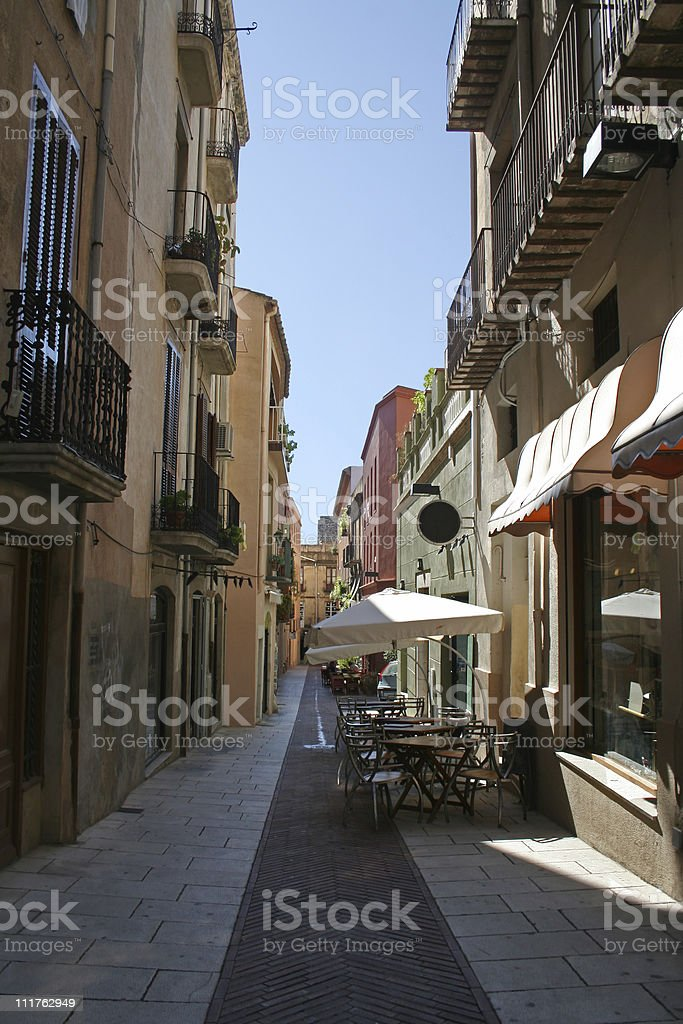 Lane in Figueres with open-air cafe stock photo