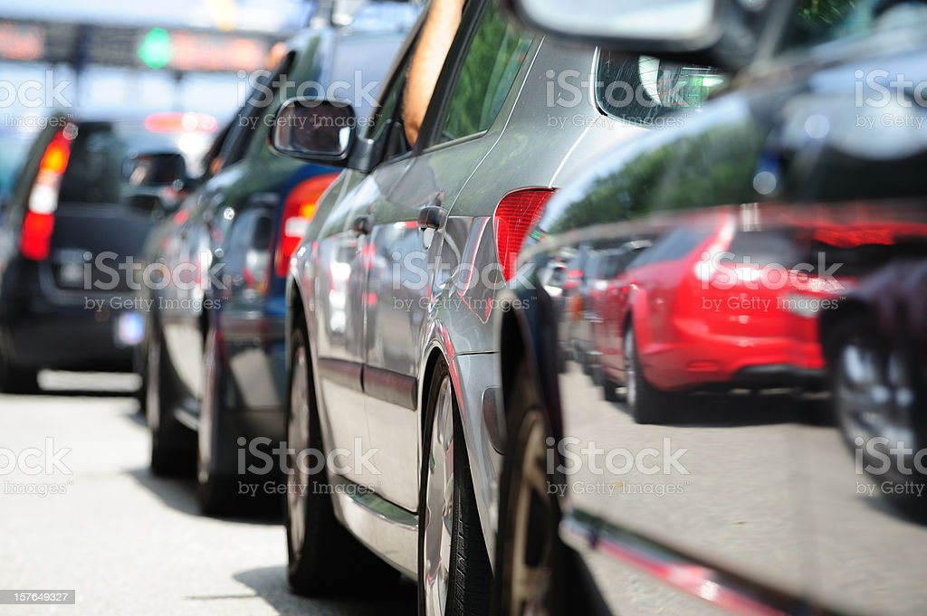 Lane of queueing cars stock photo