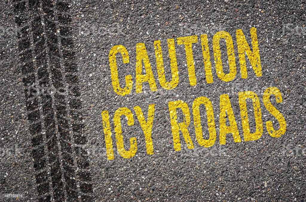 Lane with the text Caution icy roads vector art illustration