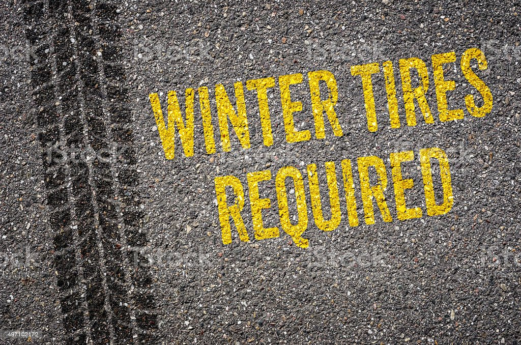 Lane with the text Winter tires required vector art illustration