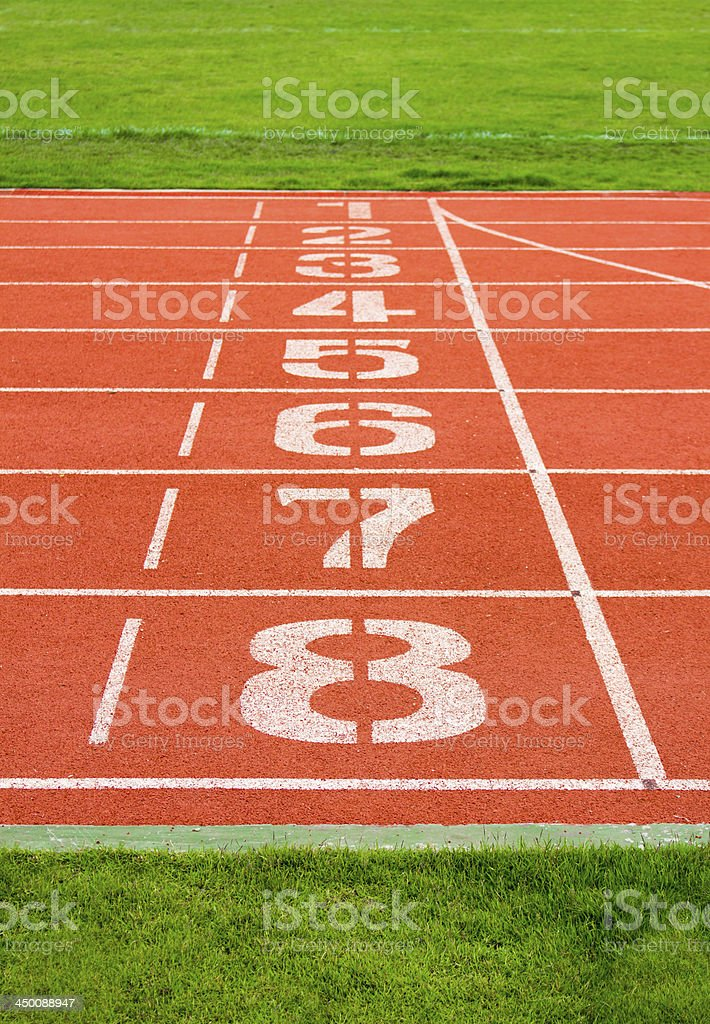 Lanes of a red race track with numbers stock photo