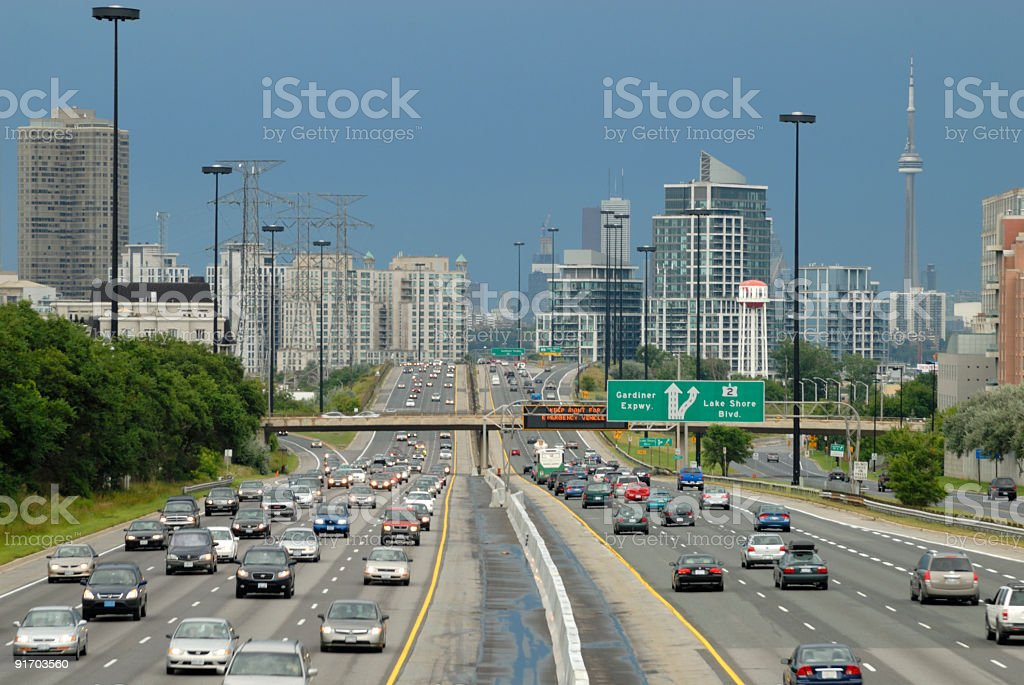 8 lanes of traffic going in & coming out of a city stock photo