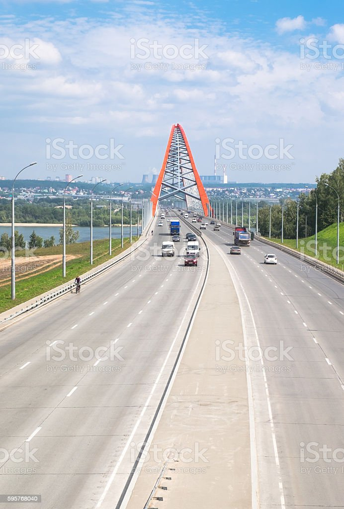 Lanes with cars and Red Bridge stock photo