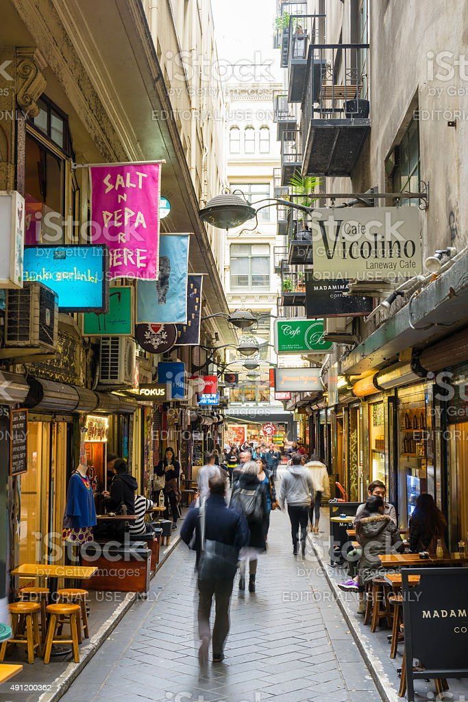 Laneway with cafes and people in Melbourne stock photo