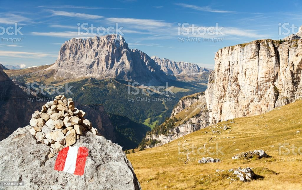 Langkofel with tourist sign, Italian dolomities mountains stock photo