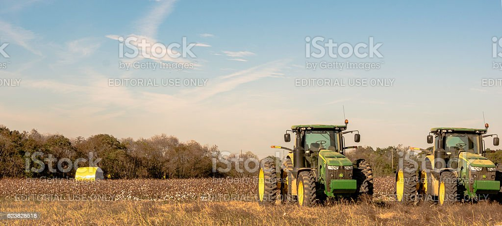 Lanscape of two John Deere tractors in a cotton field stock photo