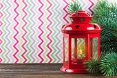 Lantern and Christmas on colored background