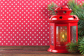 Lantern and Christmas on red background with polka dots.