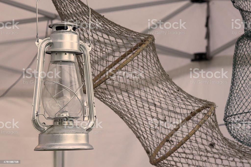 Lantern and driftnet stock photo