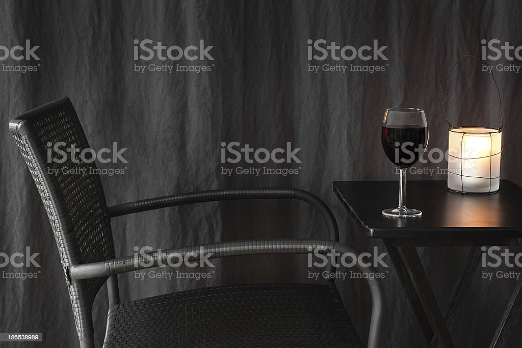 Lantern decorating a table with glass of wine royalty-free stock photo