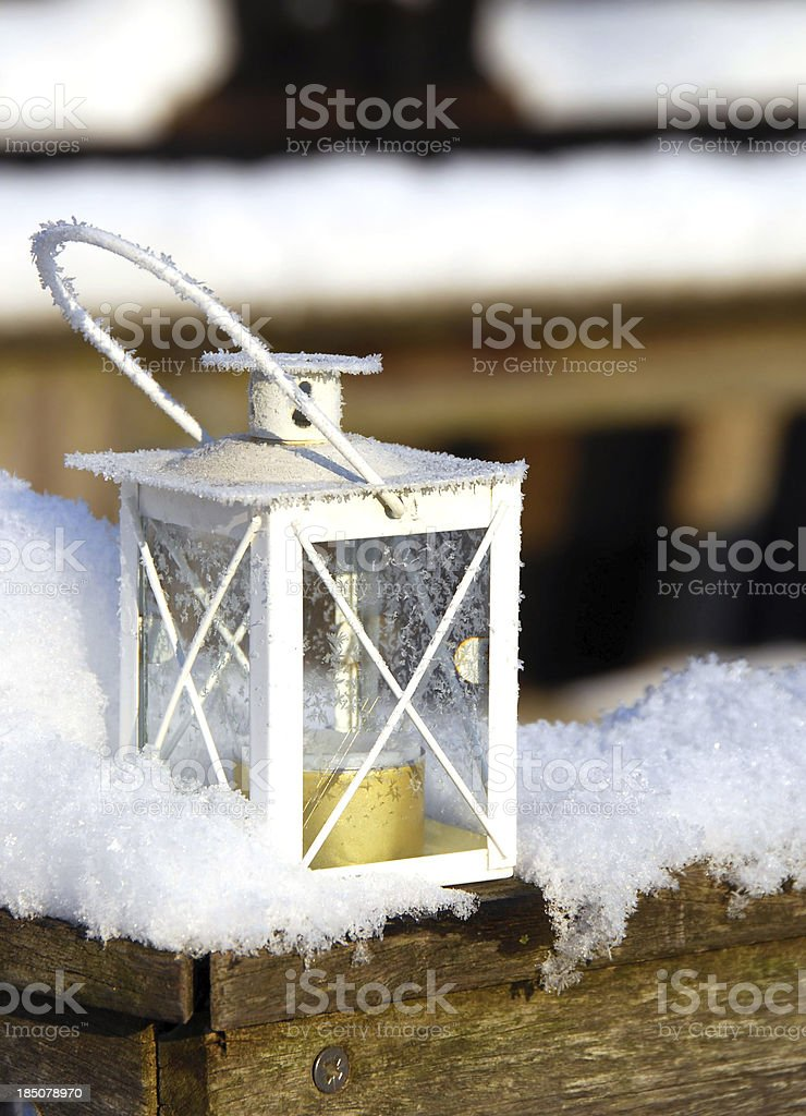 lantern decoration standing in the snow royalty-free stock photo