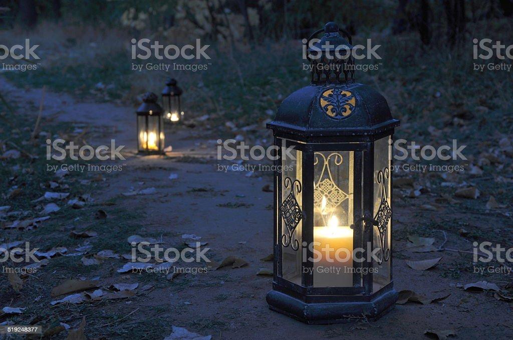 Lantern in darkness stock photo