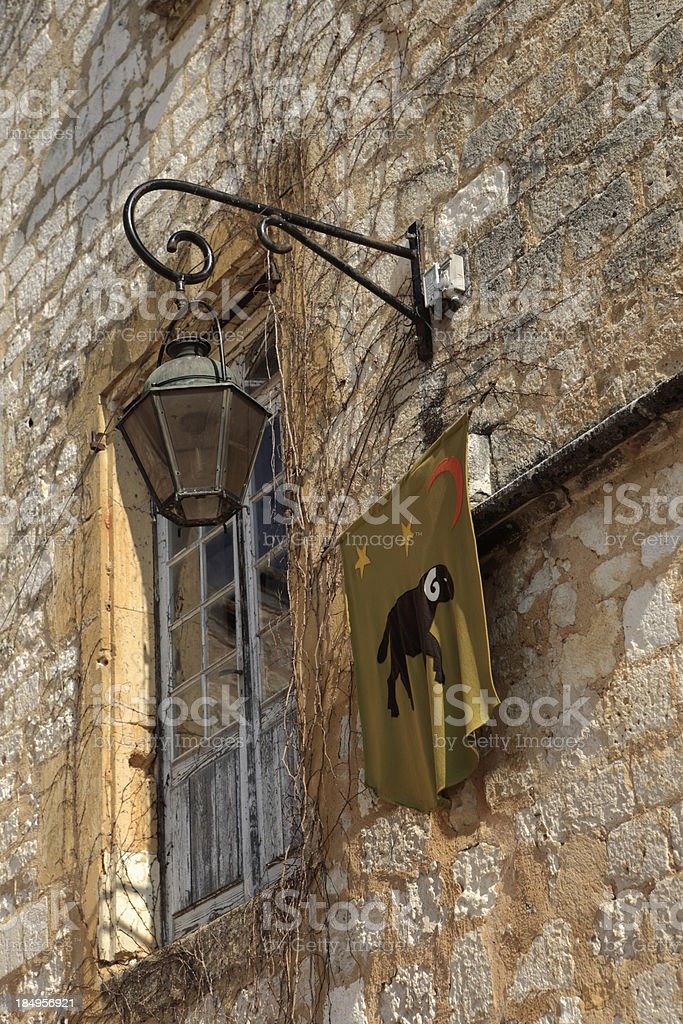 lantern on a wall in the medieval village of Monpazier royalty-free stock photo