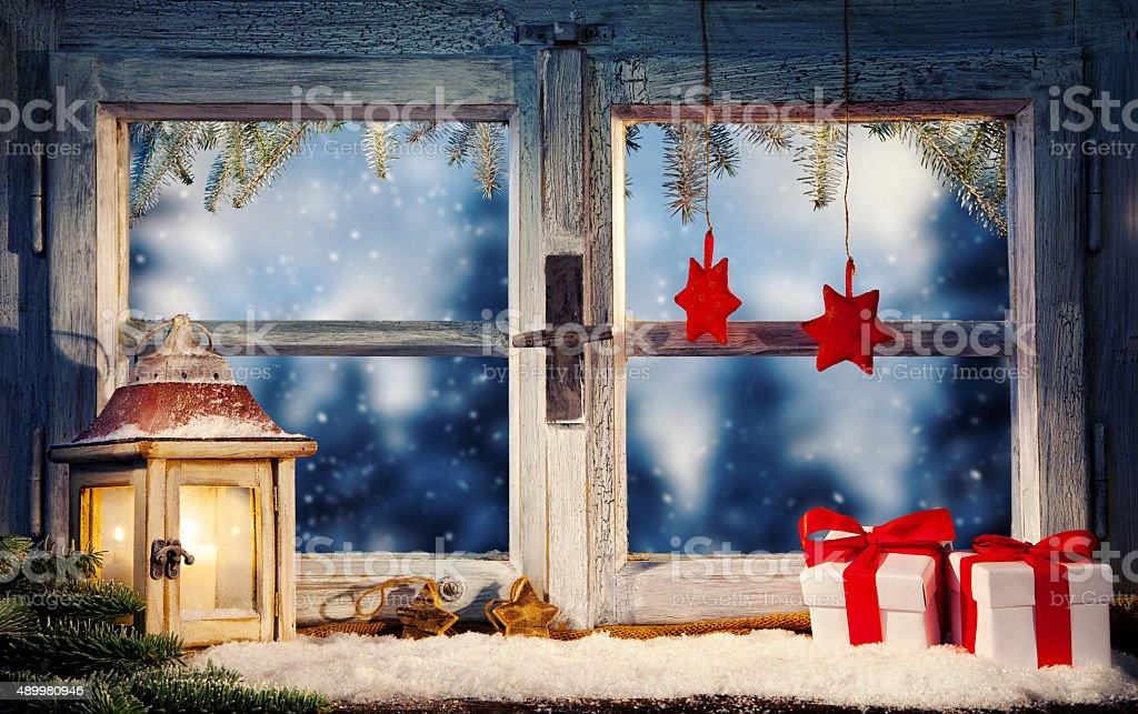 Lantern on window sill in winter stock photo