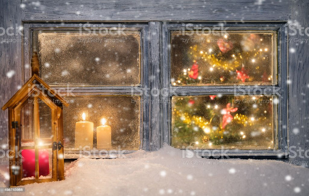 Lantern on window sill in winter stock photo