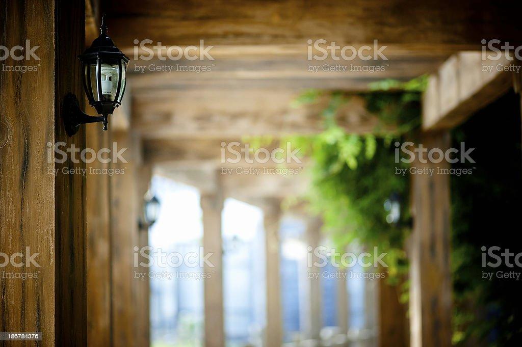 Lantern on Wooden Wall stock photo