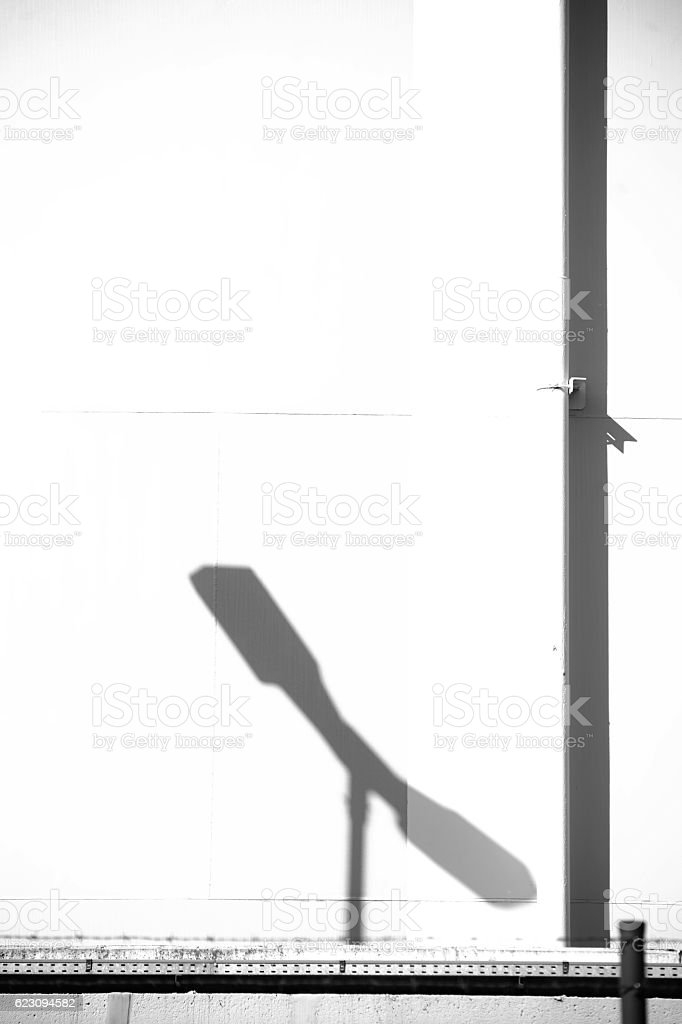 Lantern shadow on the industrial container stock photo