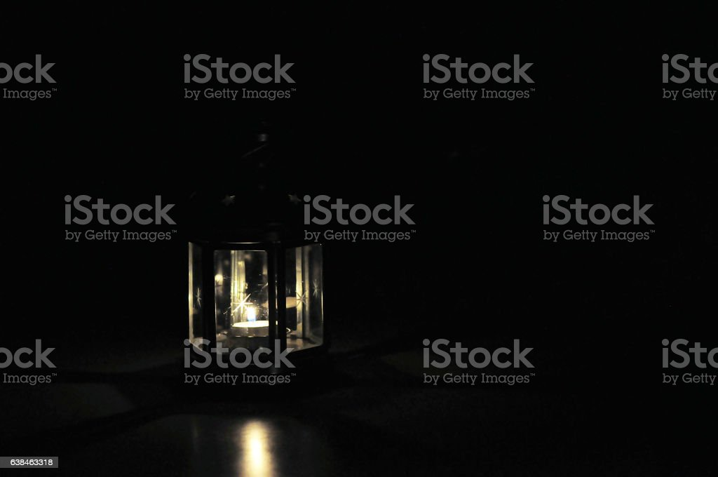 Lantern with candle in dark background stock photo