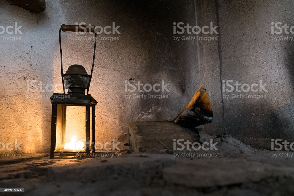 lantern with candle on an old fireplace stock photo