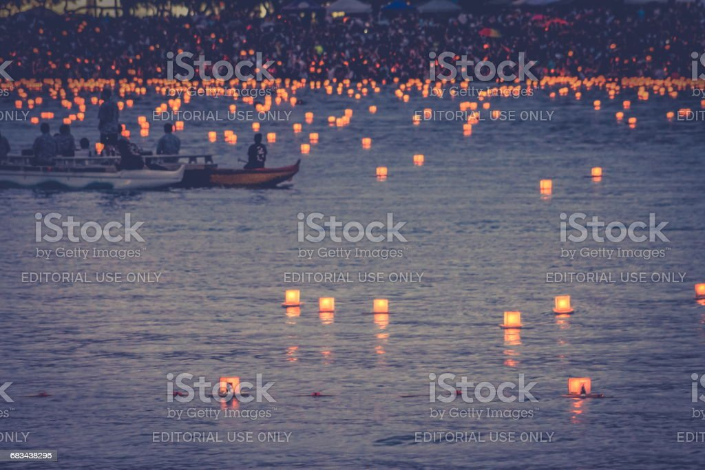Lanterns begin to be floated in the annual Memorial Day Lantern Floating Festival held at Ala Moana Beach Honolulu, Hawaii stock photo