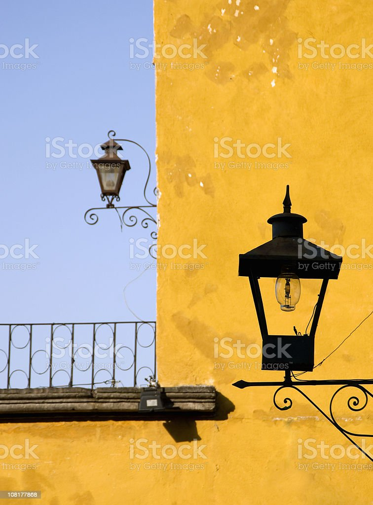 Lanterns on Yellow Building Facade royalty-free stock photo