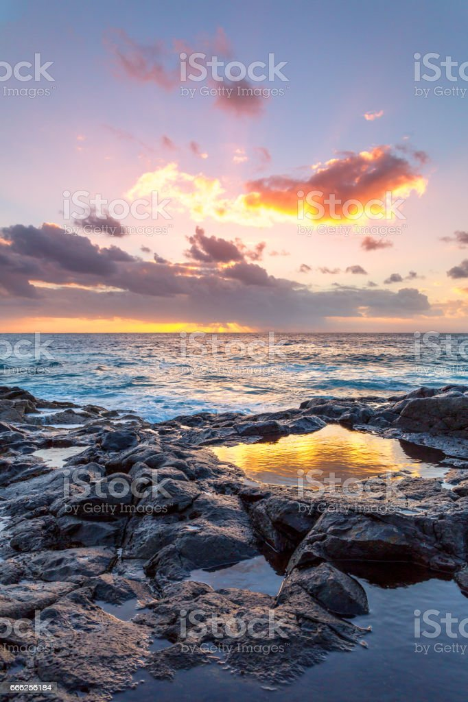 Lanzarote - golden sunset at the coast of El Golfo stock photo