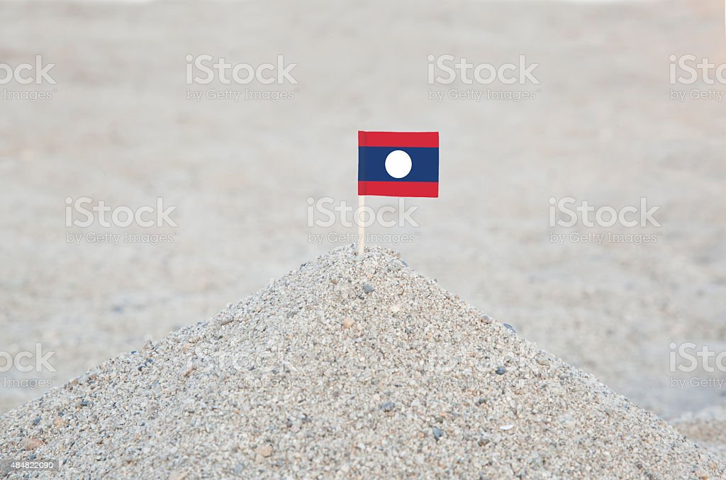 Laos Flag on the beach stock photo
