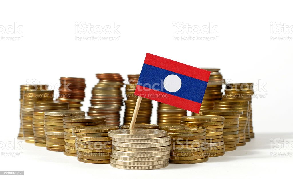 Laos flag waving with stack of money coins stock photo