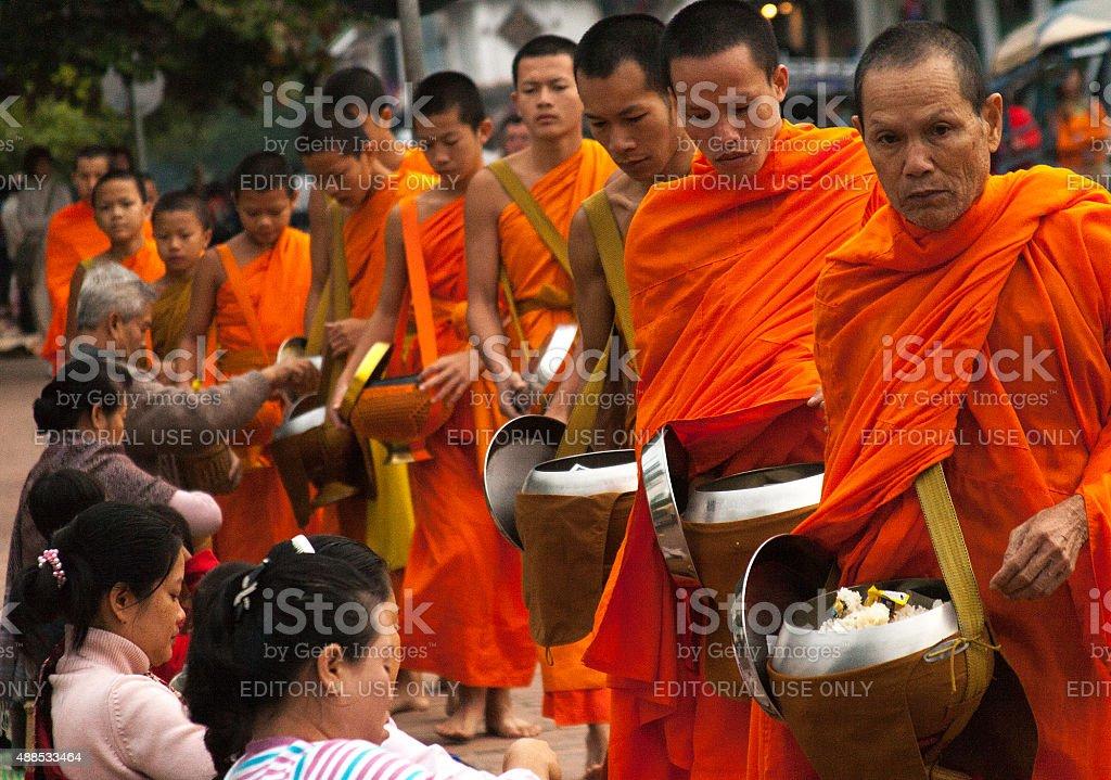 Laos: Monks Begging Alms at Dawn, Luang Prabang stock photo