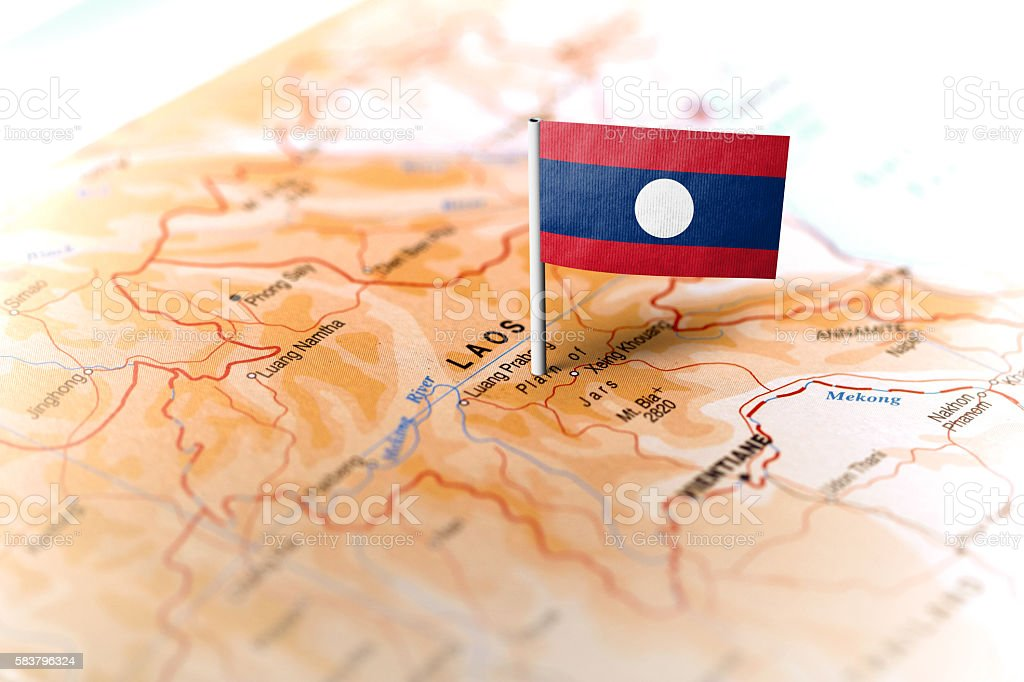 Laos pinned on the map with flag stock photo