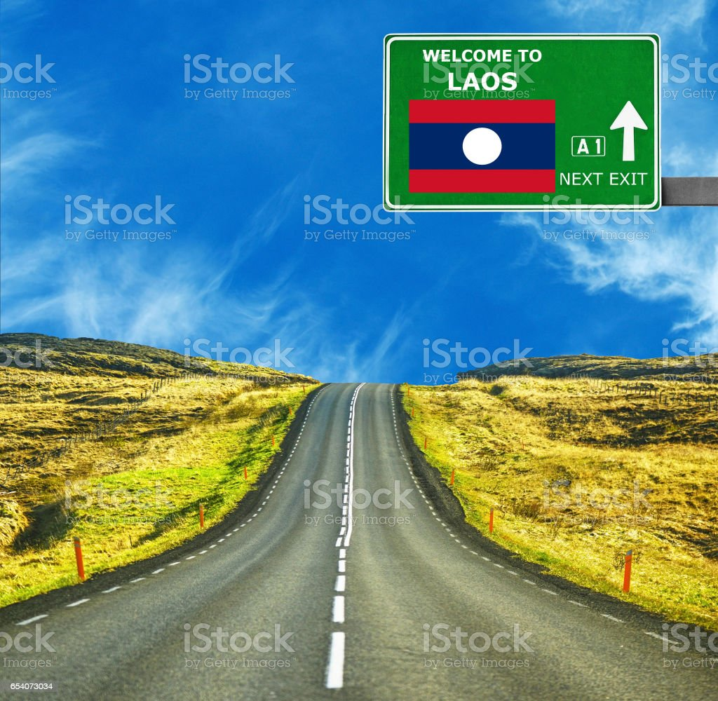 Laos road sign against clear blue sky stock photo