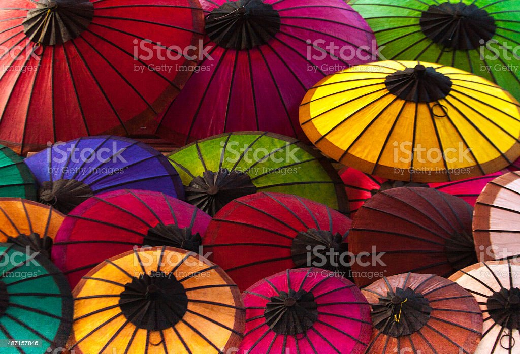 Laos: Vibrant Multi-Colored Paper Parasols at Market, Luang Prabang stock photo