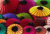 Laos: Vibrant Multi-Colored Paper Parasols at Market, Luang Prabang