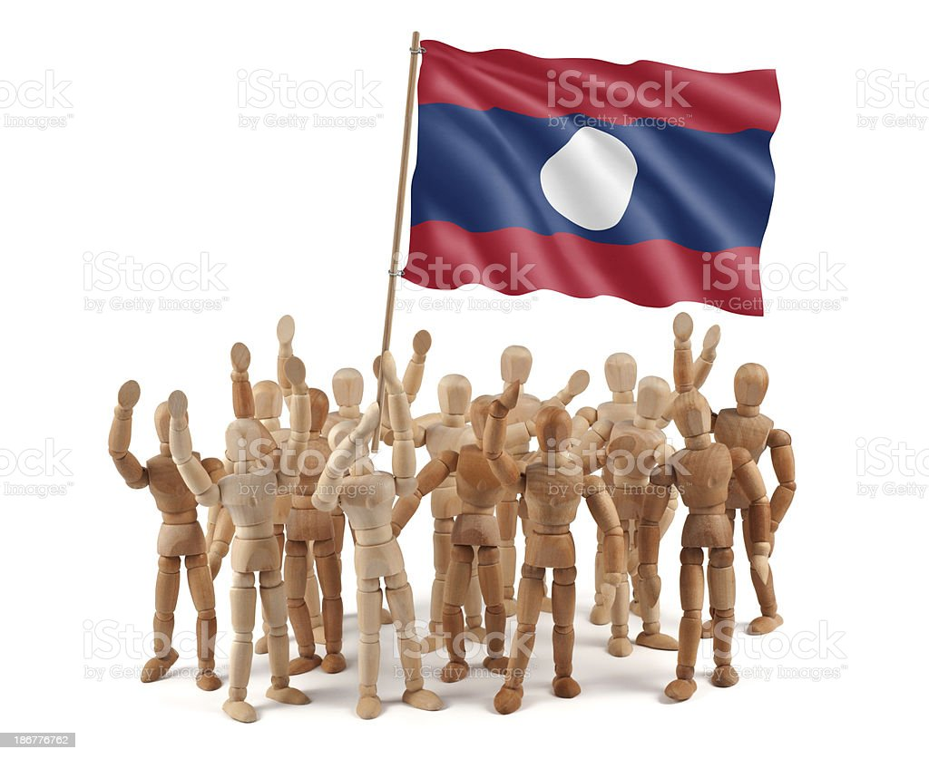 Laos - wooden mannequin group with flag stock photo