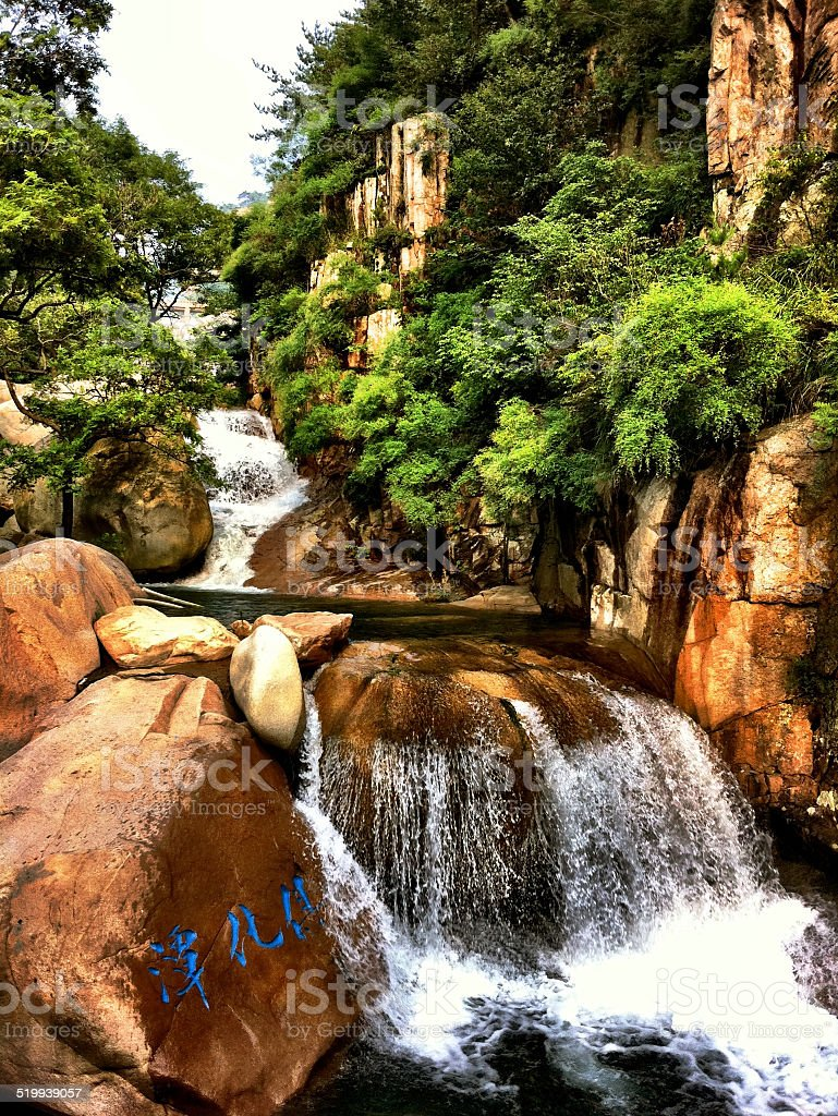 Laoshan Mountain Rock Pool and Waterfall With Taoist Inscription. stock photo