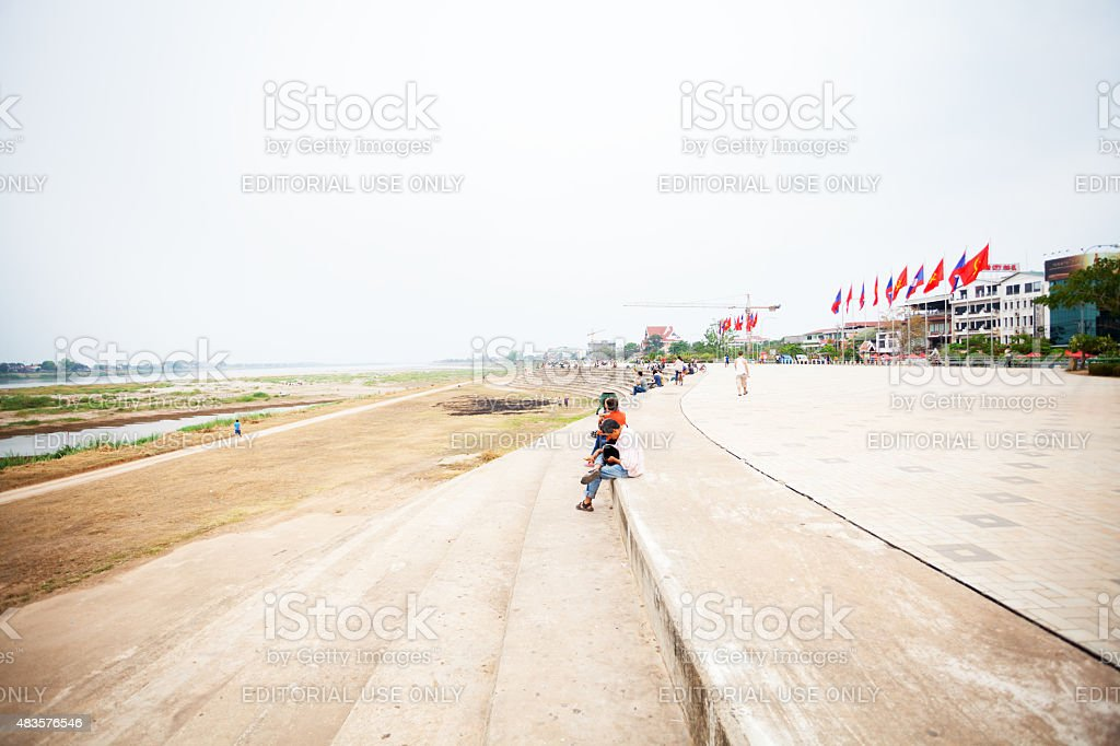 Laotian people watching Mekong and Thailand stock photo