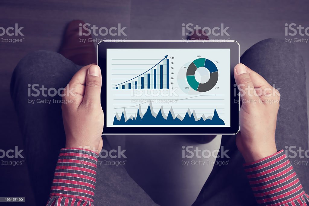 Lap point of view of man holding tablet stock photo