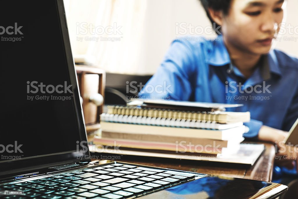 lap top with pile of paper work on working table stock photo