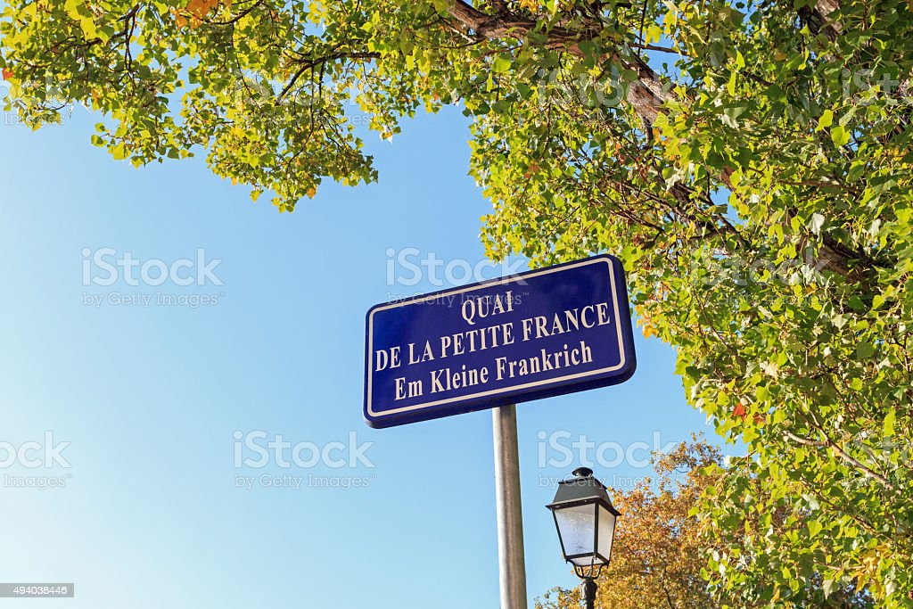 La-Petite-France: Street name sign in Strasbourg with autumn sunlight stock photo