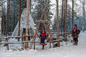 "Lapland (Finland). Two Sami people near their ""lavvu"""