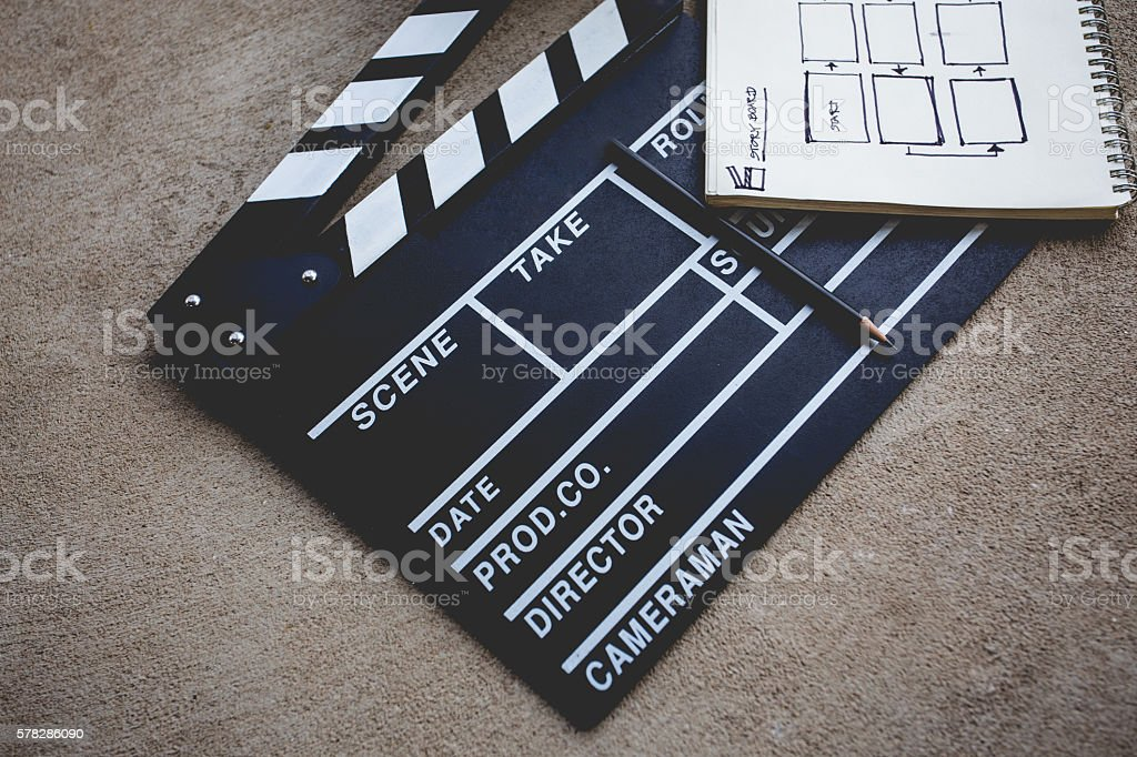 lapperboard with sketchbook for writing storyboard stock photo