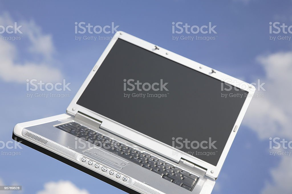 Laptop Against Blue Sky royalty-free stock photo