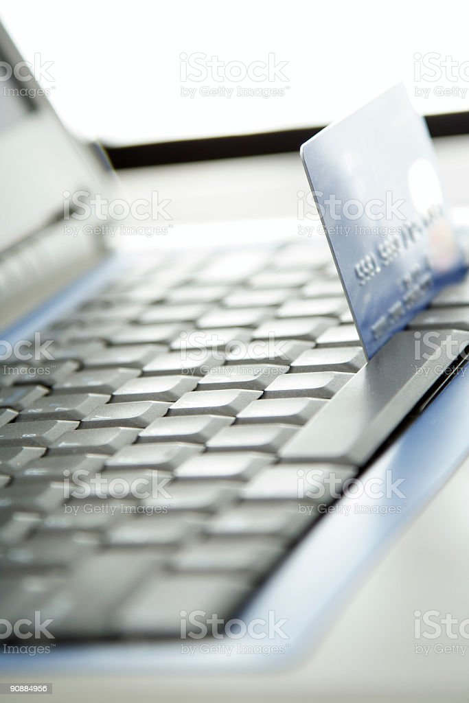 A laptop and a credit card for online shopping royalty-free stock photo