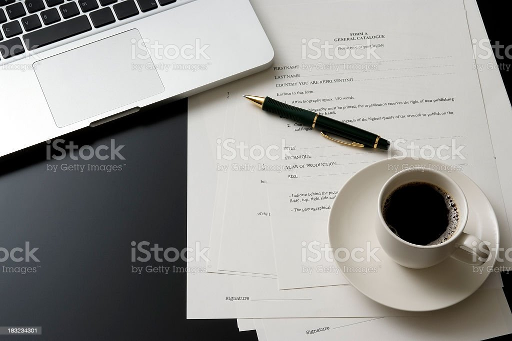 Laptop and a cup of coffee on office desk royalty-free stock photo