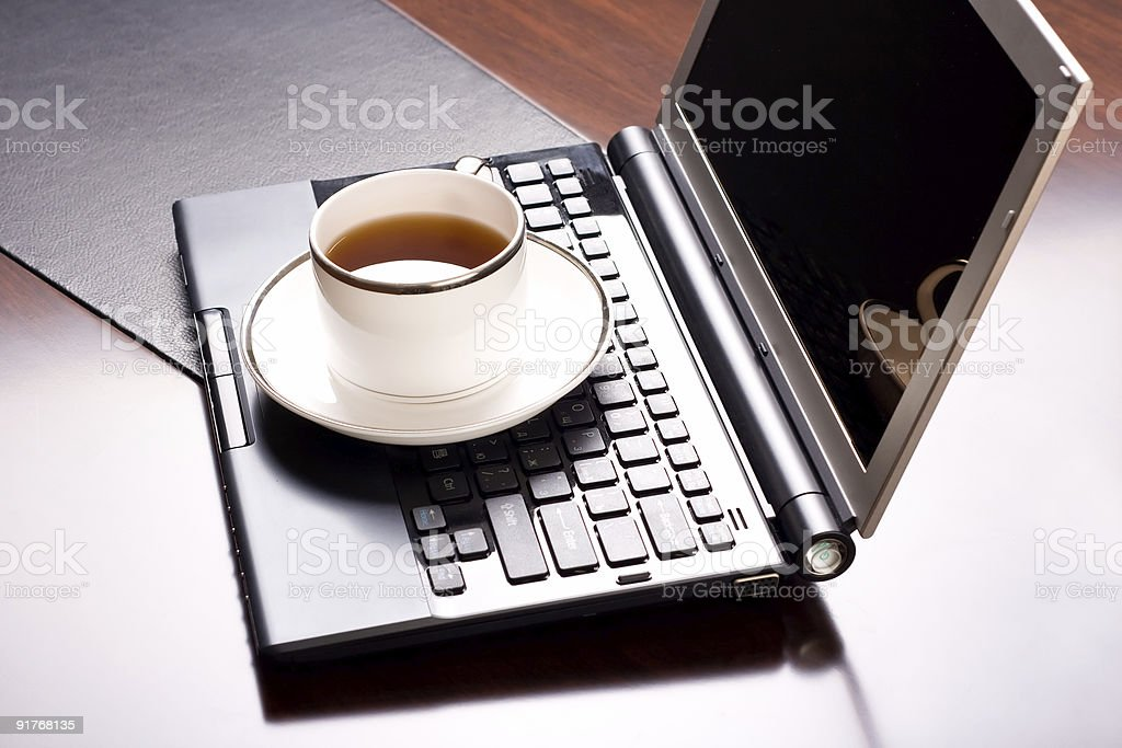 laptop and a cup of tea one royalty-free stock photo
